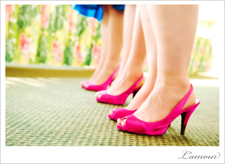 Bright blue bridesmaids dresses with hot pink shoes. A perferct color theme for an Oahu wedding.