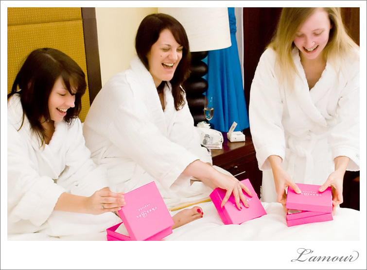 Bridesmaids opening bridal party gifts at the Moana Surf Rider Hotel in Waikiki, Oahu