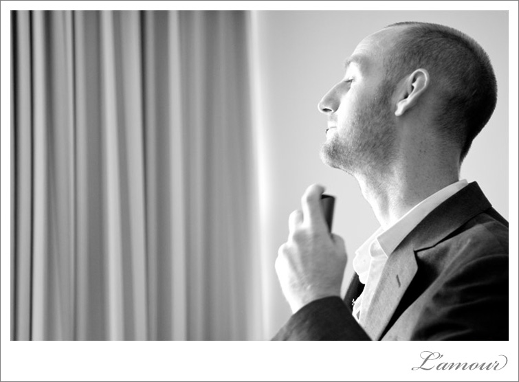 Groom spraying cologne before the wedding at the Ohana East Hotel in Waikiki, Oahu
